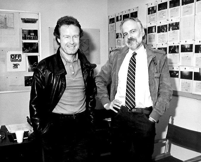 black-and-white photo of Ridley Scott and Philip K. Dick in the studio, both smiling